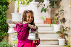 Little girl from Bulgaria with a traditional water carrying tool called `kobilitsa` Royalty Free Stock Photography