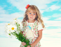 Little girl with a bunch of chamomile Stock Photography