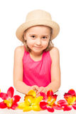 Little girl and a bunch of exotic flowers on a table Royalty Free Stock Photos