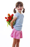 Little girl with bunch of flowers Stock Image
