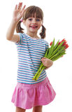 Little girl with bunch of flowers Royalty Free Stock Photography