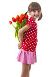 Little girl with bunch of red tulips Stock Photo