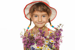 Little girl with bunch of wild flowers Royalty Free Stock Images