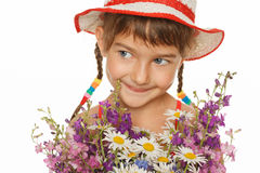 Little girl with bunch of wild flowers Royalty Free Stock Image