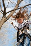 Little girl in a bungee Stock Photo