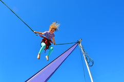 Little girl on Bungee trampoline Stock Photography