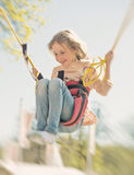 Little girl on bungee. Stock Photos