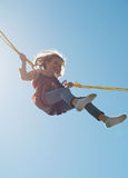 Little girl on bungee. Stock Image
