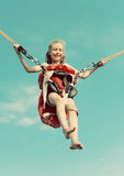 Little girl on bungee. Royalty Free Stock Photography