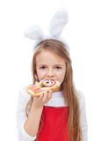 Little girl with bunny ears eating a sandwich Royalty Free Stock Photography