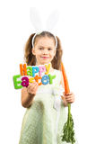 Little Girl in Bunny Ears holding Carrot Royalty Free Stock Photography