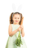 Little Girl in Bunny Ears holding Carrot Royalty Free Stock Photos