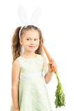 Little Girl in Bunny Ears holding Carrot Stock Photos