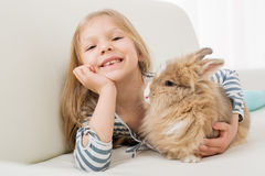 Little girl with bunny Royalty Free Stock Images