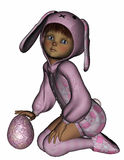 A little girl in a bunny suit with Easter egg Stock Photos