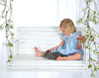 Little Girl and Bunny on Swing Stock Images