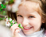 Little girl with bush blossoming Royalty Free Stock Image