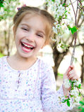 Little girl with bush blossoming Stock Photos