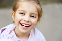 Little girl with bush blossoming Royalty Free Stock Images