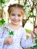 Little girl with bush blossoming Royalty Free Stock Photos