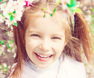 Little girl with bush blossoming Stock Images