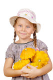 Little girl with bush pumpkins on white Stock Photography