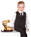 Little girl  in business suit call telephone. Royalty Free Stock Images