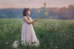 Little girl with butterflies. Fairytale portrait of Little girl with butterflies at the sunset Royalty Free Stock Images