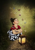 Little girl and butterflies royalty free stock images