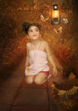 Little girl and butterflies Stock Photo