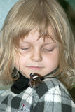 Little girl and butterfly Stock Images