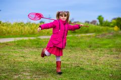 A little girl with butterfly net having fun Royalty Free Stock Image