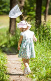 Little girl with butterfly net Royalty Free Stock Photos