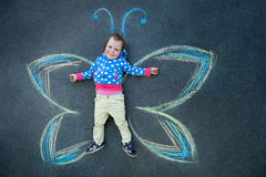 Little girl Butterfly smiling Stock Photo