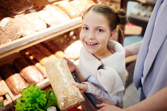 Little Girl Buying Groceries in Supermarket Royalty Free Stock Image