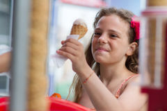 Little girl buying an ice cream Stock Photo