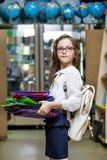 Girl school supermarket shop school stationery uniforms clothing backpack briefcase glasses purchasing choice before preparing royalty free stock photos
