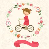 Little girl on bycicle. With floral wreath around and ribbon with place for your text Royalty Free Stock Images
