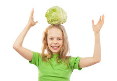 Little girl with cabbage Stock Photos