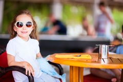 Little girl in cafe Stock Image