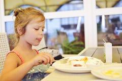 Little girl in cafe stock image