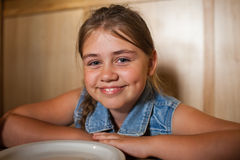 Little girl in cafe Royalty Free Stock Image