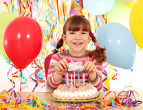 Little girl with cake and balloons birthday party Stock Image