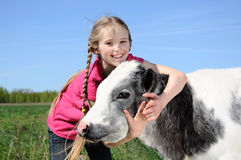 little girl with calf Royalty Free Stock Photo