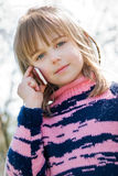 Little girl calling on cellphone Royalty Free Stock Images