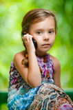 Little girl calling on mobile phone Royalty Free Stock Photography