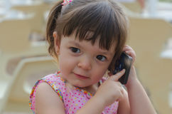 Little girl calling on the phone Stock Image