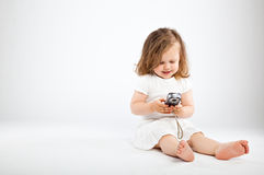 Little girl with camera. On gray background Royalty Free Stock Photos