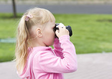 Little girl with the camera Royalty Free Stock Images