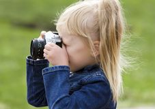 Little girl with the camera Royalty Free Stock Photography